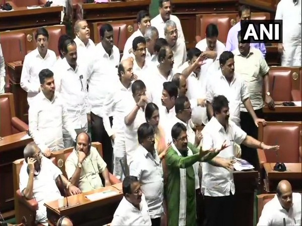Congress-JDS MLAs raising slogans -- Save the Constitution -- in the Vidhana Soudha on Monday. Photo/ANI