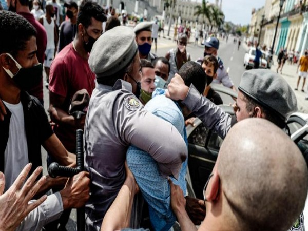Cubans protesting over lack of freedom and worsening economic condition (Photo Credit - CNN)