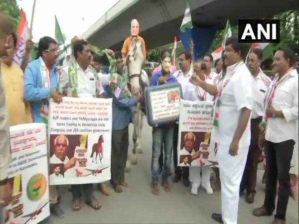 Congress-JDS workers staging protest in Bengaluru, Karnataka, on Monday. Photo/ANI