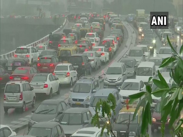 Traffic crawls on Western Express Highway as Mumbai receives heavy rainfall. [Photo/ANI]