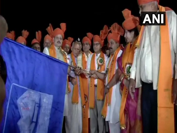 Advisor to the Governor in Jammu and Kashmir, K K Sharma flagging off the first batch of devotees for Amarnath Yatra in Jammu on Sunday. Photo/ANI