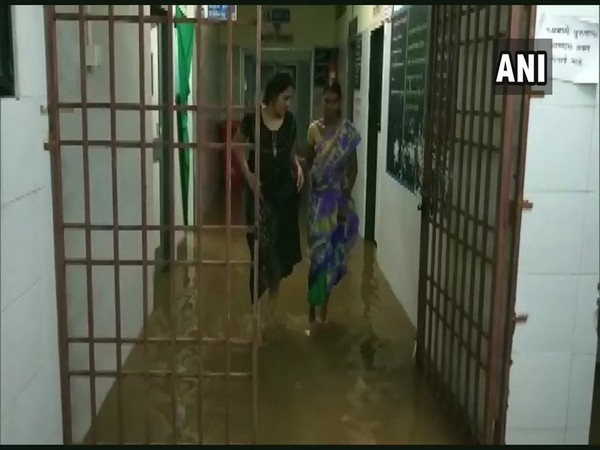In the hospital, doctors, patients and their family members could be seen wading through the water-filled corridors and wards. Photo/ANI