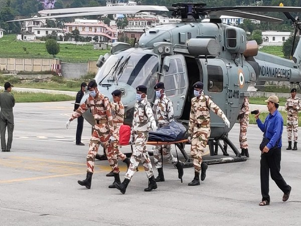 Bodies of seven mountaineers who were hit by an avalanche near Nanda Devi, brought in IAF choppers to ITBP Munsyari on Wednesday. [Photo/ANI]