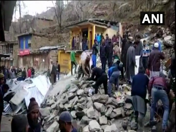 People standing around the structures damaged by landslide in Doda on Wednesday. (Photo/ANI)