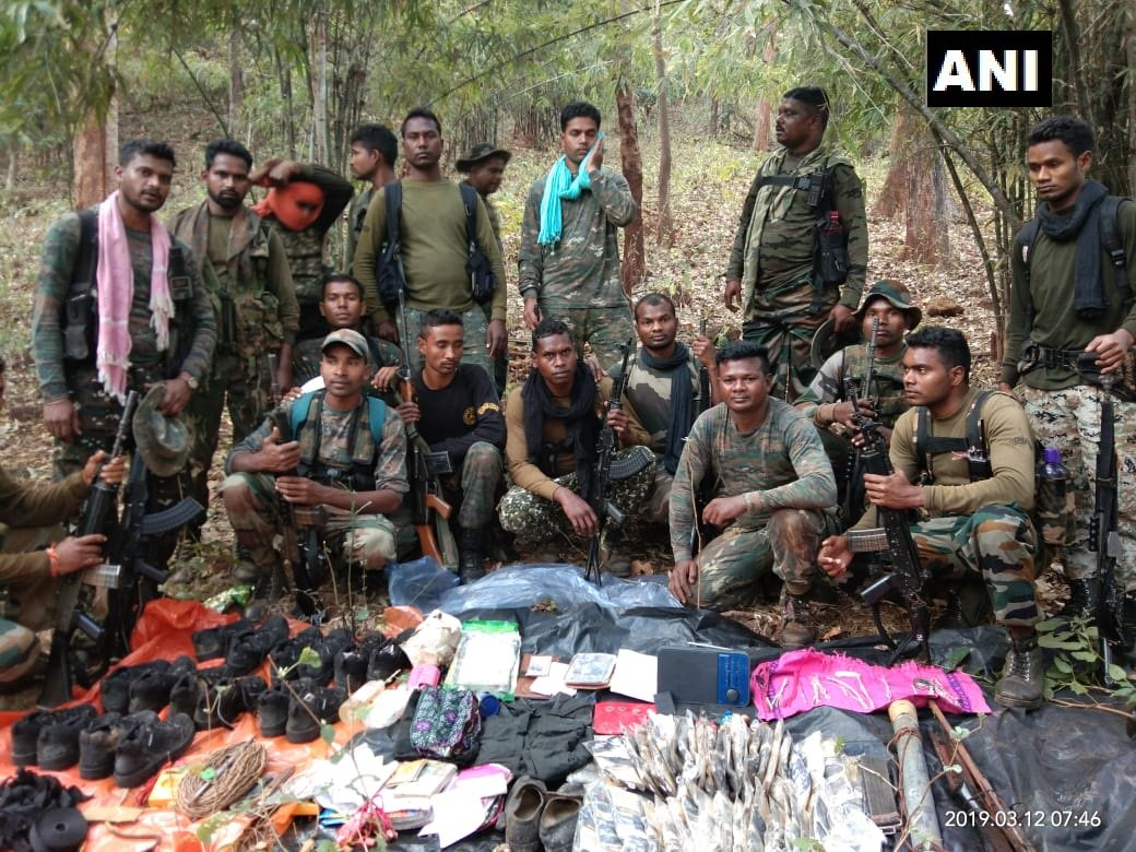 Security forces with seized items fron the Naxal hideout on Wednesdy (Photo/ANI)