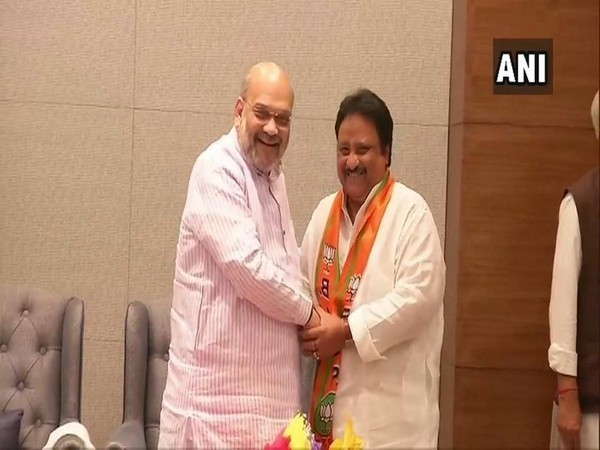 Jithender Reddy being inducted into BJP in New Delhi on Wednesday by party president Amit Shah. Photo/ANI