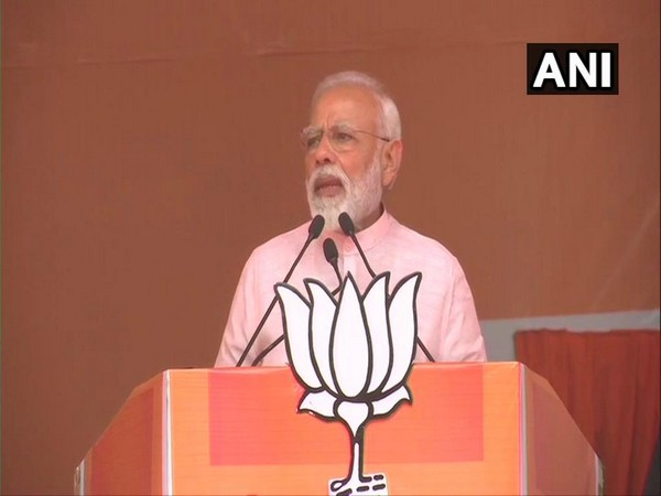 PM Narendra Modi while speaking at a rally in Amroha in UP on Friday (Photo/ANI))