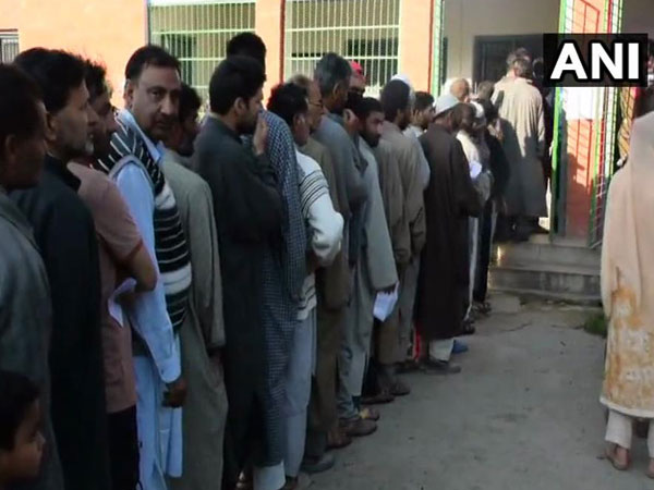 People at a polling booth in Khrew area of  Pulwama in Jammu and Kashmir.