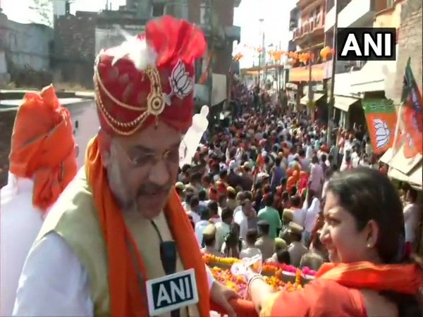 BJP president Amit Shah and Union Minister Smriti Irani during the roadshow in Amethi, Uttar Pradesh on Saturday. Photo/ANI