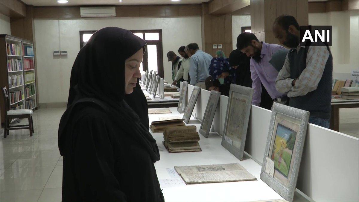 Women having a glance at Shri Pratap Singh library in Srinagar on Sunday. Photo/ANI