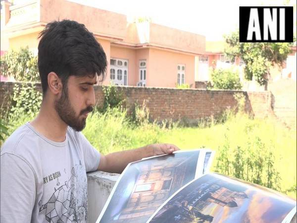 An Udhampur-based artist Abhinav Behal while showing some of his artwork (Source: ANI)