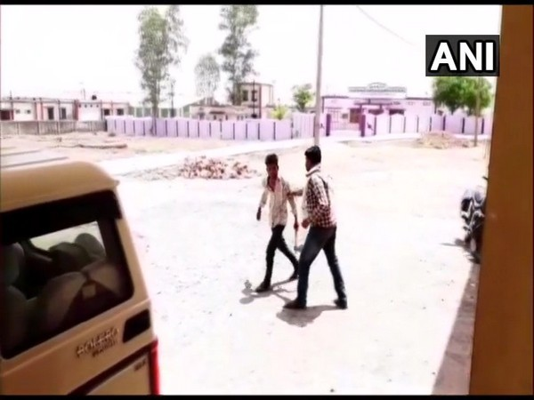 A man spotted with with a hatchet outside the Block Office of Damoh on Thursday. [Photo/ANI]