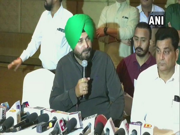Congress leader Navjot Singh Sidhu addresses media in Indore on Saturday. [Photo/ANI]