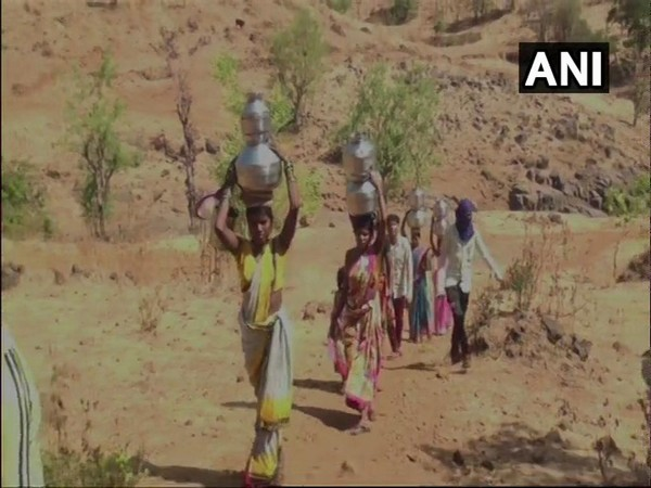 Woem often have to travel long distances to fetch water. Photo/ANI