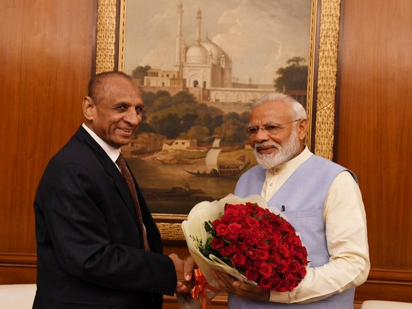 Prime Minsiter Narendra Modi with Andhra Pradesh Governor ESL Narasimhan in New Delhi on Friday.