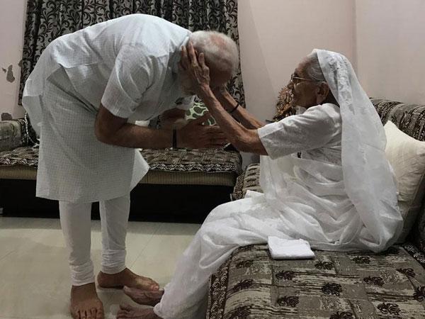 Prime Minister Narendra Modi meets his mother Heeraben Modi at her residence in Gandhinagar