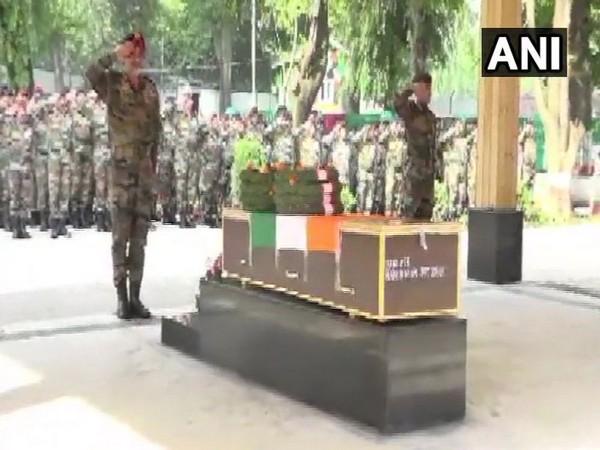 Indian Army paying tribute to paratrooper Karamjeet Singh on Saturday. Photo/ANI