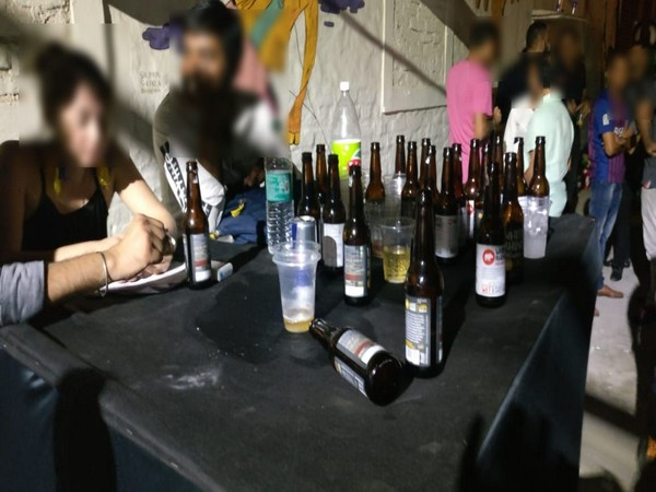 A large amount of drugs and foreign liquor was seized in the raid in Chhbarapur, New Delhi, on Saturday night. (Photo/ANI)