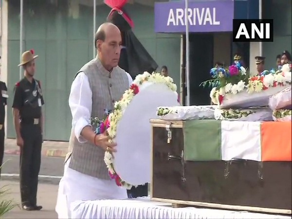 Union Defence Minister Rajnath Singh paid tribute to deceased Army jawan Lance Naik Mohammad Jawed in New Delhi on Tuesday. Photo/ANI