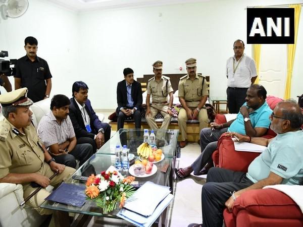 Karnataka CM HD Kumaraswamy holds a meeting with officials before his 'village stay programme' in Raichur. [Photo/ANI]