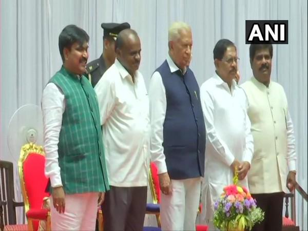 R Shankar and H Nagesh with Chief Minister HD Kumaraswamy at Rajbhavan on Friday. Photo/ANI