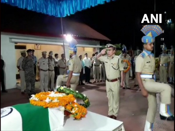 Security personnel and officers pay floral tribute to Sunil Kalita at Guwahati airport