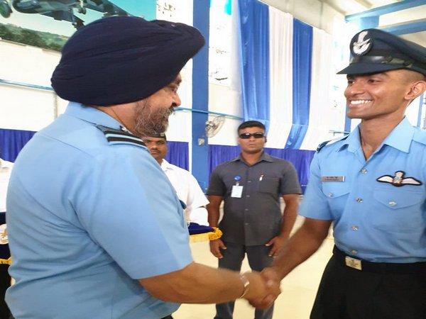 IAF Chief BS Dhanoa greets Flying Officer Navin Reddy, winner of 'Sword of Honour'