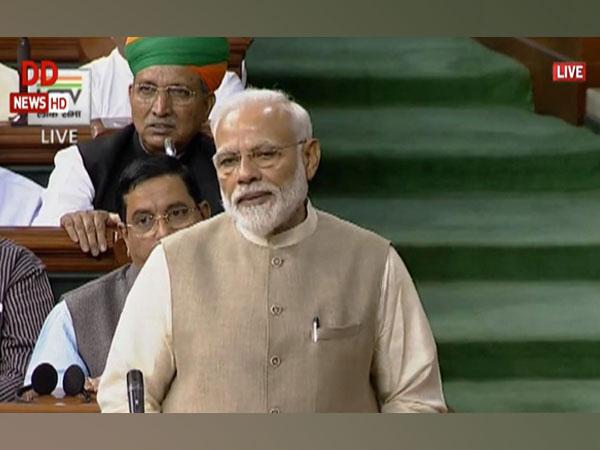 Prime Minister Narendra Modi speaking in the Lok Sabha on Wednesday.  (Courtesy: LSTV)