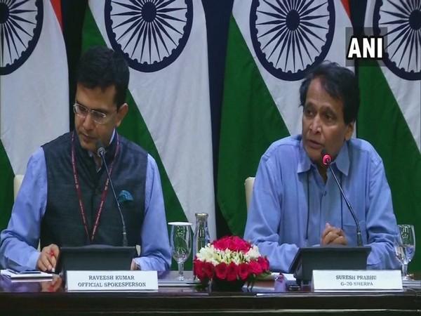 MEA spokesperson Raveesh Kumar and former Union Minister Suresh Prabhu (Photo/ANI)