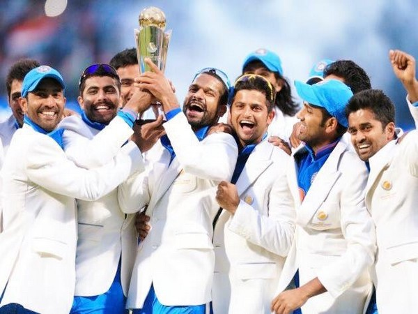 Indian team with the Champions Trophy. (Photo/ Suresh Raina Twitter)