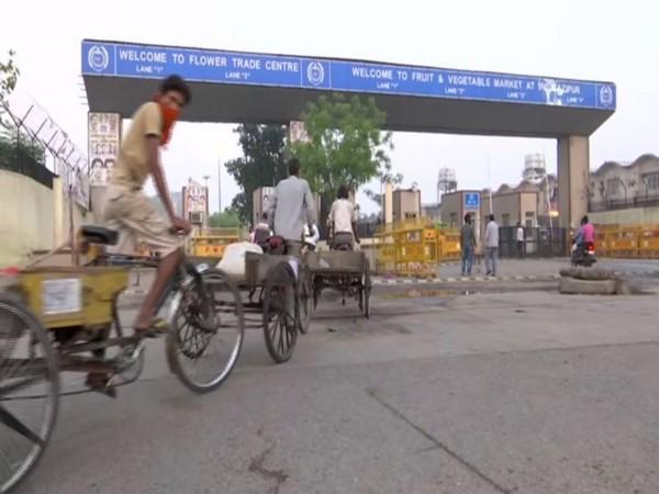 People arrive at Delhi's Gazipur market to buy essentials amid #Unlock1. (Photo/ANI)