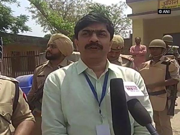 DM Akhilesh Kumar speaking to reporters in Shamli