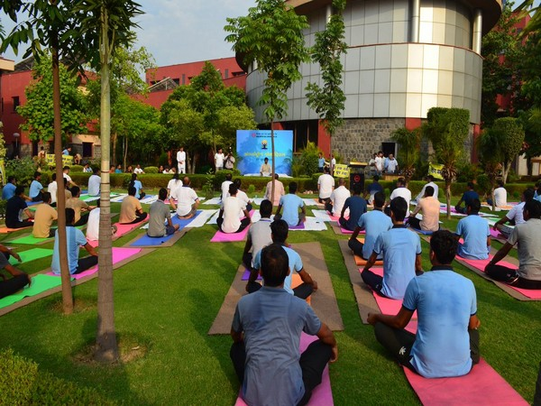 DMRC staff and employees performing yoga on the occasion of 5th International Yoga at Shastri Park metro depot in New Delhi on Friday. (Picture Credits: DMRC Twitter)