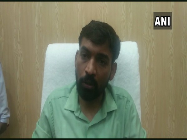 Uttarkashi District Magistrate Dr Ashish Chauhan talking to reporters on Sunday. (Photo/ANI)