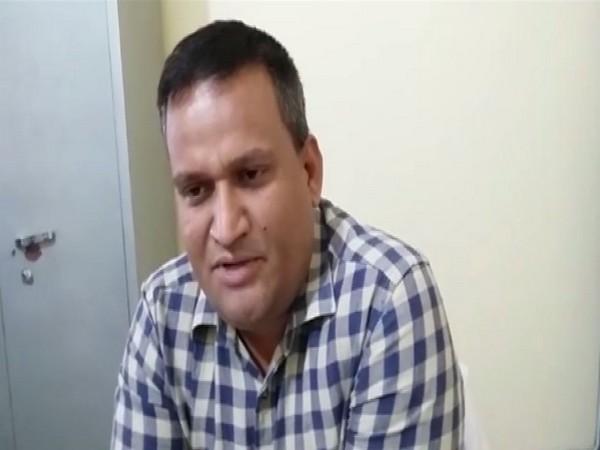 DM Amrit Tripathi speaking to ANI in Shahjahanpur. Photo/ANI