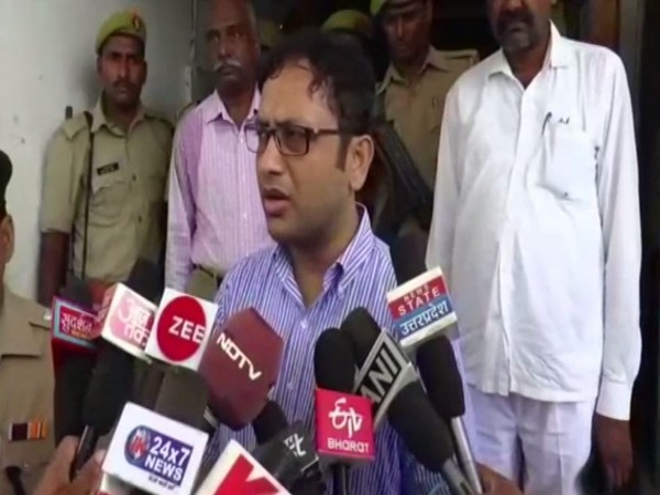 District Magistrate Sripati Mishra speaking to reporters on Sunday.