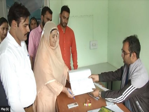 Sharifa Begum, a 64-year-old woman, filing her nomination for Block Development Council polls in Doda district. Photo/ANI