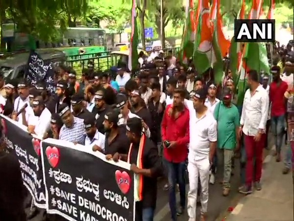 Youth Congress workers march from Cubbon Park to Raj Bhawan in Bengaluru on Tuesday. (Photo/ANI)