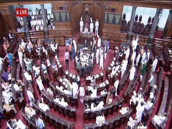 Opposition members storm the well of the Rajya Sabha over Karnataka political crisis