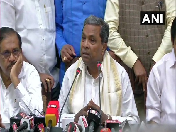Former Karnataka Chief Minister Siddaramaiah talking to media persons after the CLP meeting in Bengaluru on Tuesday.