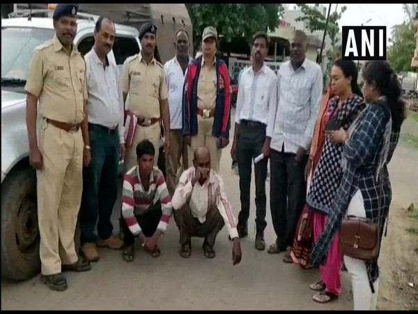 Police officials with the two accused. Photo/ANI