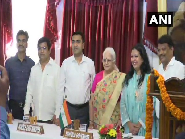 Goa Governor Mridula Sinha, Chief Minister Pramod Sawant along with newly inducted ministers at Raj Bhawan in Panaji, Goa on Saturday. Photo/ANI
