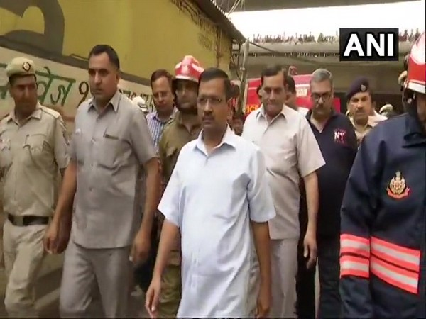 Chief Minister Arvind Kejriwal visiting rubber factory which was gutted in a fire in Jhilmil Industrial area on Saturday. Photo/ANI