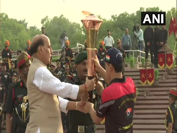 Defence Minister Rajnath Singh holding the 'Victory Flame' on Sunday.