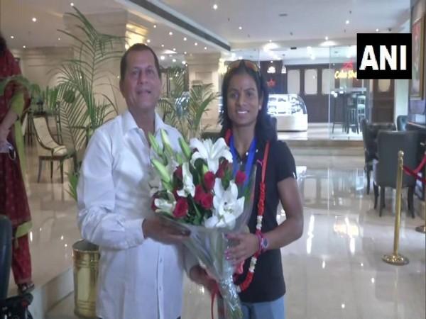 BJD MP Achyuta Samanta with sprinter Dutee Chand
