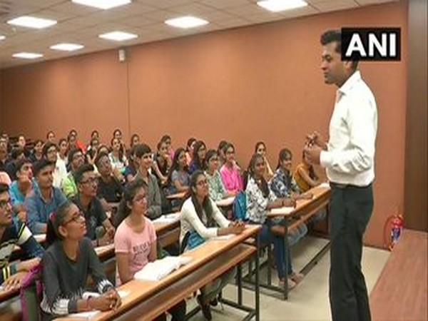 CA Ravi Chhawchharia teaches underprivileged students at his coaching centre in Surat. [Photo/ANI]