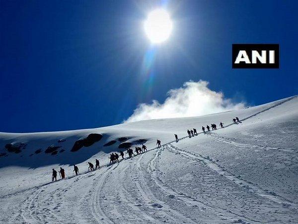 Pilgrims moving towards  Shrikhand Mahadev peak [Photo/ANI]