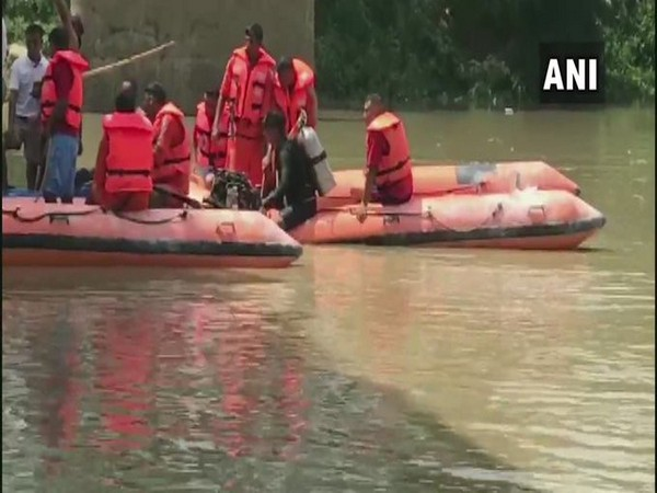 Rescue operation underway at Lilong Bridge in Imphal, after a car fell into a river yesterday. [Photo/ANI]