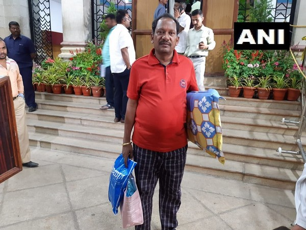 BJP legislator Prabhu Chauhan seen coming with a bed and pillow for the protest in the Vidhana Soudha