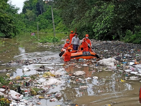 NDRF team rescues 9 people trapped in flooded ashram on the banks of Narmada river in Gujarat on Monday. (Photo: Twitter)
